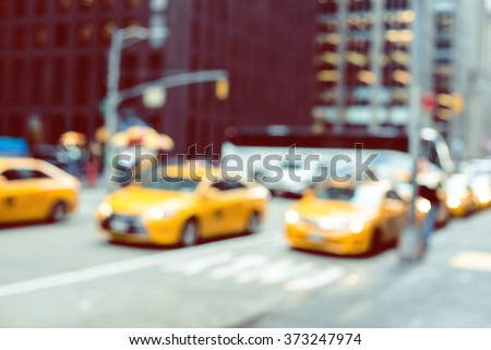 Blurred picture of yellow taxies on Manhattan streets  - stock photo