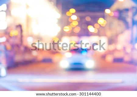 Blurred police car on the street at night. - stock photo