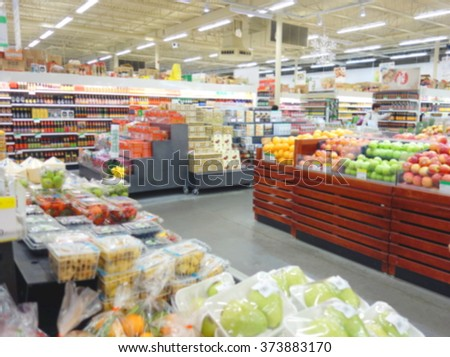Blurred produce section at a supermarket in Toronto, Canada - stock photo