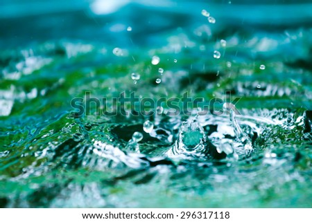 blurred Rain on water  background. - stock photo