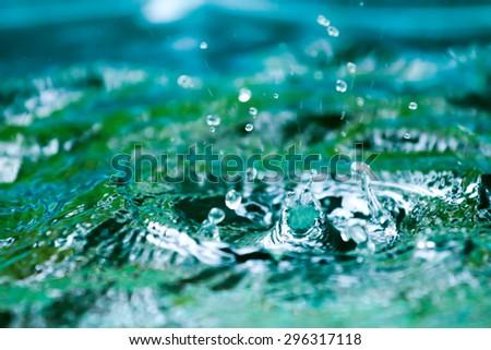 blurred Rain on water  background. - stock photo