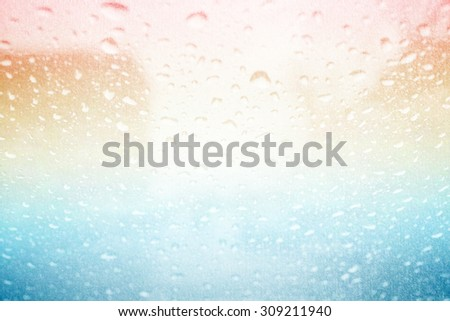 blurred raindrops on glass with fog on abstract pastel  gradient background with grunge paper texture - stock photo