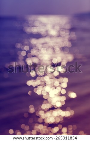 Blurred reflection in water, bokeh light abstract background. - stock photo