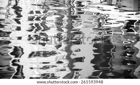Blurred reflection of colorful houses on the water. Venice, Italy. Blurred abstract background. Aged photo. Black and white. - stock photo