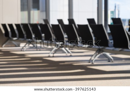 Blurred resting leather chairs with space in waiting lounge area