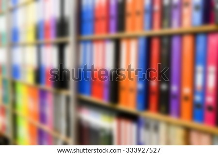 blurred row of binders in office supply store