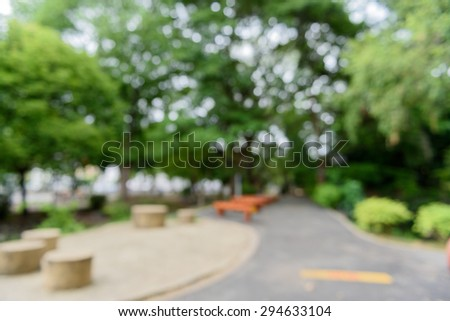 Blurred running road in park with bokeh background. - stock photo