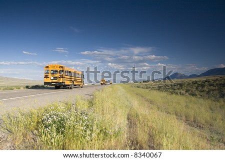 Blurred school bus on the road - stock photo
