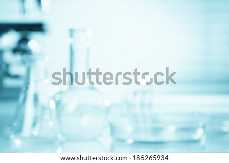 Blurred science background, test tubes and microscope with copy-space
