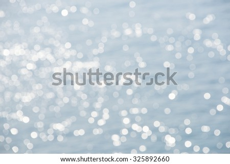 Blurred seascape background with sun flares
