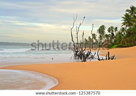Blurred seascape, long exposure taken on tropical beach during monsoon time at dusk, Tangalla, Sri Lanka - stock photo