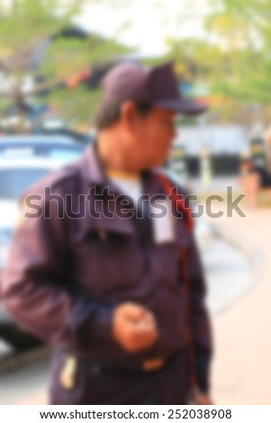 blurred security men - stock photo