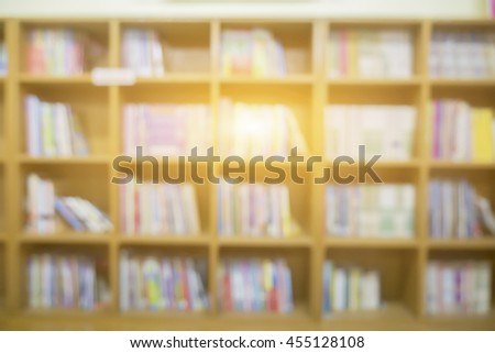 Blurred Shop Background in Book store Shelf Natural bokeh ,out of focus of people in library,Books in public library, background concept,vintage color - stock photo