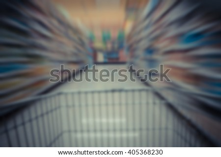 Blurred Shopping in supermarket with shoping cart , process in vintage style - stock photo