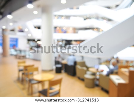 blurred shopping mall - seat and table blur background