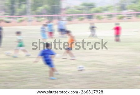 blurred shot of soccer field at school on day time  motion blur image