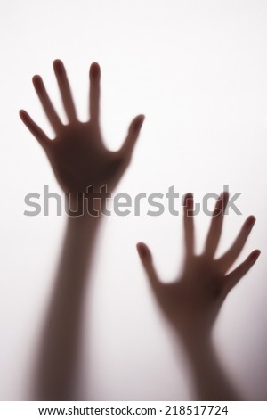 blurred silhouette hands. - stock photo