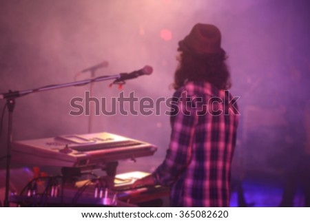 blurred singer and musician on concert - stock photo