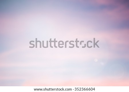 Blurred soft sweet colored bright background of evening nature firmament with lens flare lights.abstract gold hour dusk backdrop:shimmer glint shine illuminated sun ray.clouds colored gradient display - stock photo