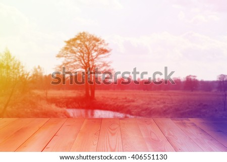 Blurred spring landscape. Spring landscape with wooden background. Beautiful  tranquil spring landscape. - stock photo