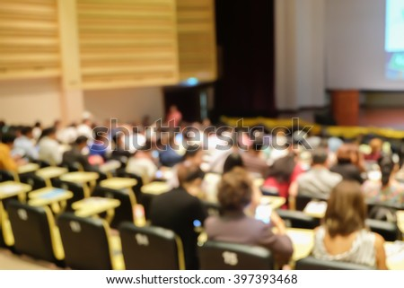 blurred student sitting for seminar or meeting about business program backgrounds:blur collaboration seminar discussion and listening in convention hall:blur inside meeting hall backdrop concept. - stock photo