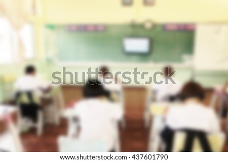 Blurred students in classroom, distance learning, long distance learning, formal learning, television study, special education, adult education, - stock photo