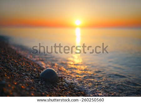 Blurred summer sea at dawn in vintage style - stock photo