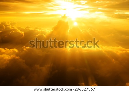 Blurred Sunset or sunrise on clouds,power light rays dramatic effect