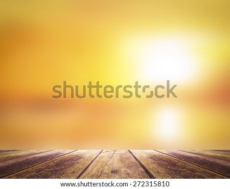 Blurred sunset over the sea with wooden paving. International Mountain Day concept. - stock photo