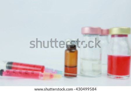 Blurred Syringes and vial in the hospital.  : medication, drugs, blood, laboratory. - stock photo