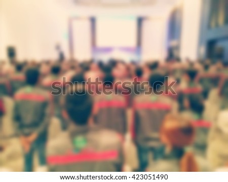 Blurred technicians are trained prior to installation to customers style vintage tone. - stock photo