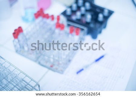 Blurred test tube on blue tone. - stock photo