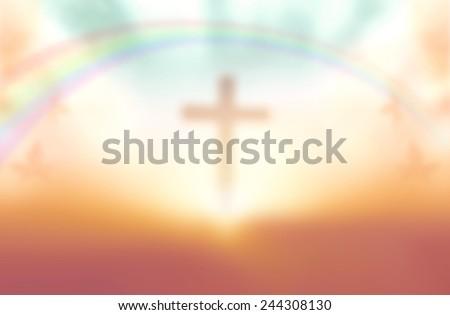 Blurred the cross on a beautiful sunset. - stock photo
