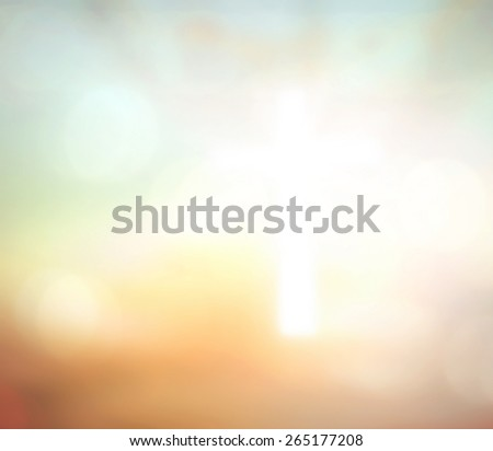 Blurred the white cross over sunset background. - stock photo
