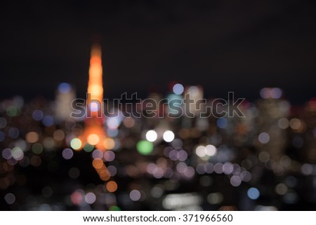 Blurred TOKYO cityscape at dusk - stock photo
