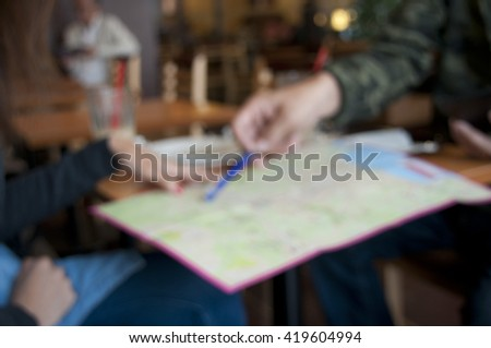 blurred tourist using map