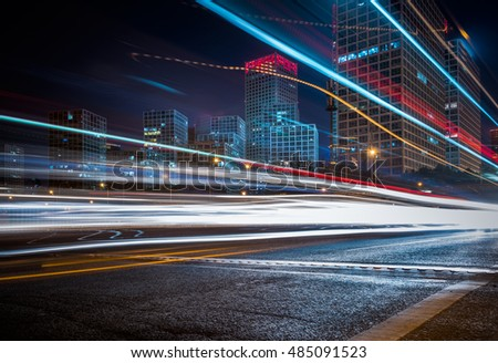 blurred traffic light trails on road at night in China.