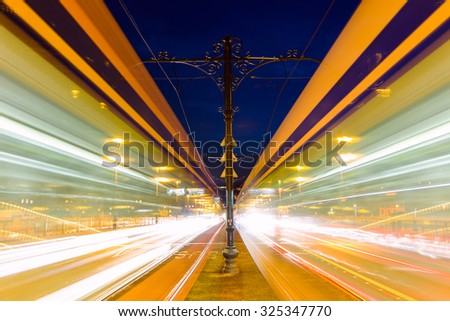 Blurred tram in Margeret bridge at night Budapest - Hungary - stock photo
