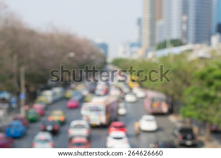 Blurred unfocused city view at day time. Unfocused people in the way - stock photo