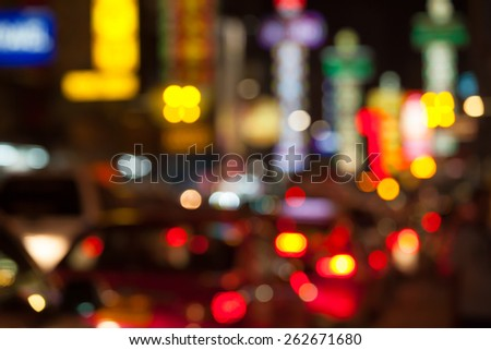 Blurred unfocused city view at night in Thailand - stock photo