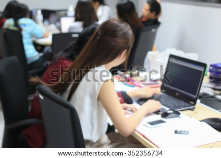 blurred university students training/reading/disciplining lesson for examination:blur group of asian pupil practice homework in silence room at library:blurry of education computer programing concept. - stock photo
