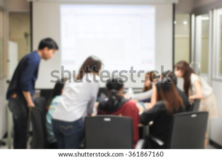 blurred university students training/reading/disciplining lesson for examination:blur group of asian pupil doing and practice homework in silence classroom at library:blurry of education concept.