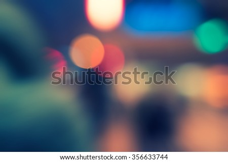 Blurred urban building background scene in the night toned in vintage retro looking color, a lot of space for text  - stock photo