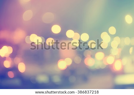 Blurred urban traffic background scene at night - stock photo