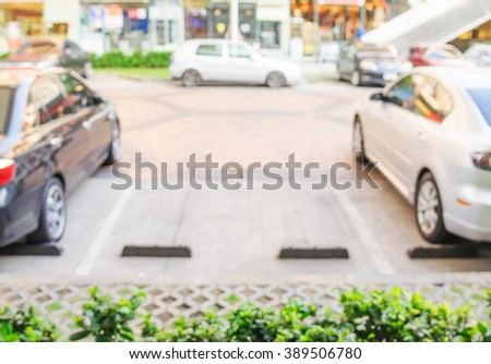 Blurred vacant parking lot background - stock photo