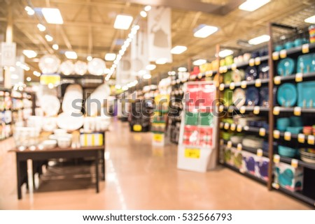 Blurred Variety Of Kitchen Utensils And Colorful Plates, Bowls And Cups Of  Every Shape And