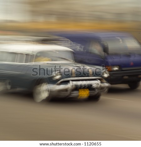 Blurred view of a car and a van on a road, Havana, Cuba - stock photo