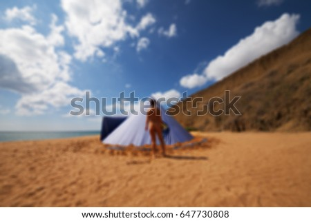 Blurred view of conical tent and sunbathing girl on summer beach with cloudy blue sky. & Conical Tent Stock Images Royalty-Free Images u0026 Vectors ...