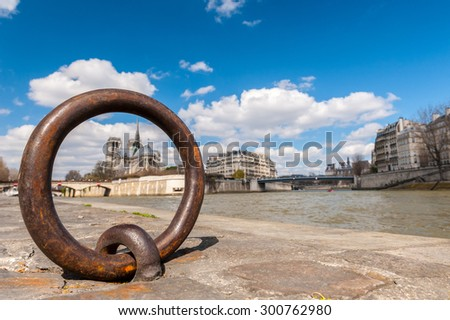blurred view of Notre Dame trough Ring for anchoring boats along the Seine river - stock photo