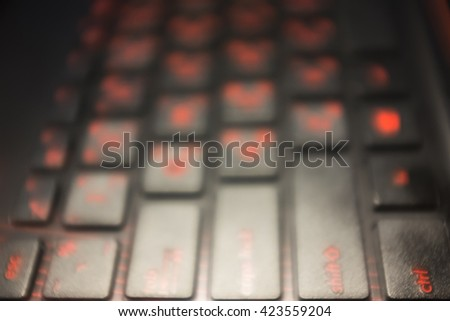 Blurred view of touching computer keyboard. An idea for inspiration with low light.  - stock photo
